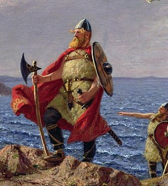 Viking warriors landing on beach.